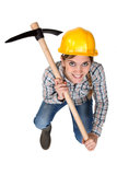 A female construction an pickaxe. Stock Images
