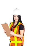 Female construction worker. With a clipboard, hard hat and safety vest Stock Photography
