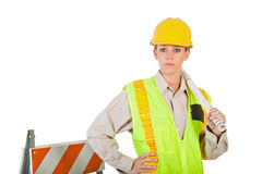 Female Construction Worker. A young female construction worker holding blueprints royalty free stock image