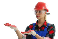 Female construction worker. A female construction worker holding her hands up as if to present something Royalty Free Stock Photos
