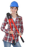 Female construction worker. In a checked shirt Royalty Free Stock Photo