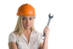 Female construction worker. With hard hat and wrench or spanner, white background Stock Photography