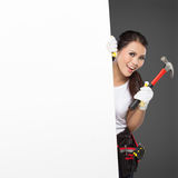 Female construction worker in action Stock Photography