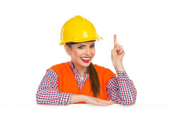 Female Construction Worker Behind Placard Pointing Up Royalty Free Stock Images