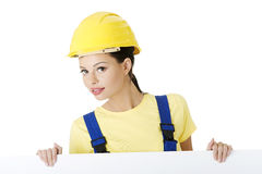 Female construction worker with blank board Stock Photos