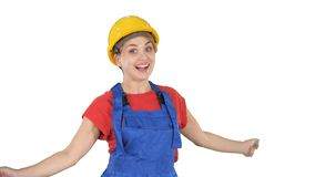 Female construction worker dancing happy on white background. stock photos