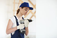 Female Construction Worker Drilling Walls Royalty Free Stock Image
