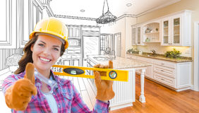 Female Construction Worker In Front of Custom Kitchen Drawing Stock Image