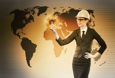 The female construction worker in globalisation concept. Female construction worker in globalisation concept stock images