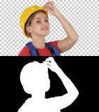 Female construction worker greeting, Alpha Channel royalty free stock images