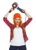 Female construction worker in a hard hat with angle grinder over Stock Photography