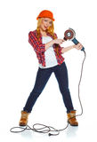 Female construction worker in a hard hat with angle grinder over Stock Image
