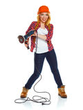 Female construction worker in a hard hat with angle grinder over Royalty Free Stock Photography