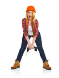 Female construction worker in a helmet with a perforator Royalty Free Stock Photos