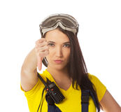 A female construction worker holding a down signal Royalty Free Stock Image