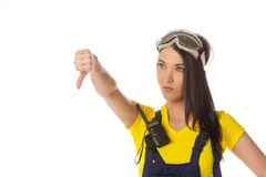 A female construction worker holding a down signal Stock Image
