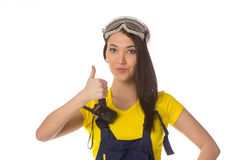 A female construction worker holding a ok signal Stock Photos