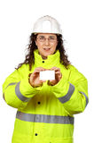 Female construction worker holding one blank card Stock Image