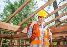 Female Construction Worker Holding Pipe And Hammer Stock Photos