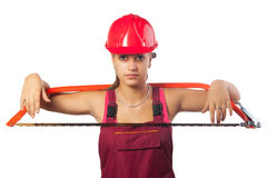 Female construction worker holding saw Stock Image