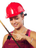 Female construction worker holding saw Stock Photo