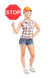 Female construction worker holding a stop sign Stock Photography