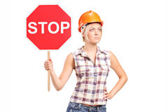 Female construction worker holding a stop sign Royalty Free Stock Image