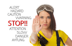 A female construction worker holding a stop signal Royalty Free Stock Photos