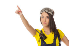 A female construction worker holding an up signal Royalty Free Stock Images