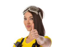 Female construction worker holding an up signal Royalty Free Stock Image