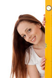 Female construction worker with  level. Royalty Free Stock Photography