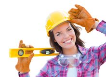 Female Construction Worker with Level Wearing Gloves and Hard Hat. Young Attractive Female Construction Worker with Level Wearing Gloves, Hard Hat and Protective royalty free stock photography