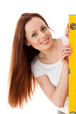 Female construction worker with  level. Royalty Free Stock Photo