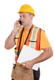 Female construction worker looking at plans on a new home constr Royalty Free Stock Photography