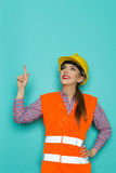Female Construction Worker Looking Up And Pointing Royalty Free Stock Images