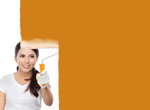 Female construction worker painting Stock Photo