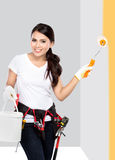 Female construction worker painting Royalty Free Stock Photo