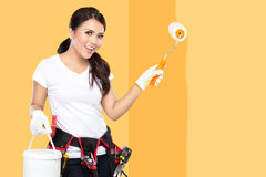 Female construction worker painting Royalty Free Stock Photography