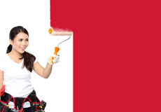 Female construction worker painting Stock Image