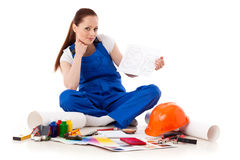 Female construction worker with plan of house. Royalty Free Stock Images