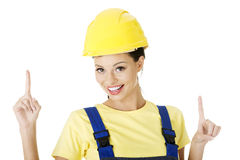 Female construction worker pointing on copy space Royalty Free Stock Images
