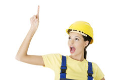 Female construction worker pointing on copy space Stock Photos