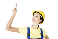 Female construction worker pointing on copy space Royalty Free Stock Photography