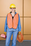 Female construction worker posing in hard-hat Royalty Free Stock Photo