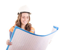 Female construction worker reading blue prints Royalty Free Stock Image