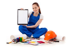 Female construction worker shows blank clipboard. Royalty Free Stock Photos