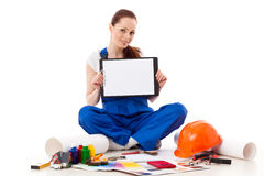 Female construction worker shows blank clipboard. Stock Photos
