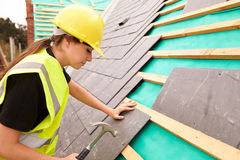 Female Construction Worker On Site Laying Slate Tiles Stock Photography