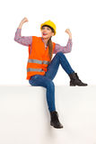 Female Construction Worker Sitting And Cheering Stock Images