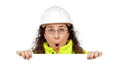 Female construction worker surprised. Behind the  blank banner Stock Image